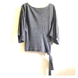Cashmere sweater with split sleeves and side tie